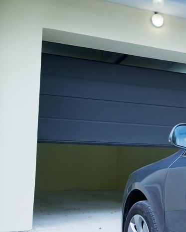 Installation porte garage service portails for Porte de garage installation